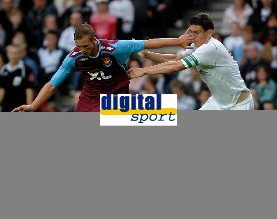 Photo: Richard Lane/Sportsbeat Images.<br />Milton Keynes Dons v West Ham United. Pre Season Friendly. 25/07/2007. <br />West Ham's Jack Collison battles with Don's Keith Andrews (rt).