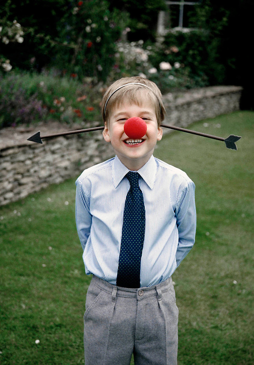 Prince William seen having fun in the garden at his home Highgrove House in August 1988. Exclusive photograph by Jayne Fincher