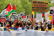 Activists from an International Bloc highlighting current human rights abuses in Palestine, Israel, Colombia and Tigray join tens of thousands of people on the National Demonstration for Palestine on 22nd May 2021 in London, United Kingdom. The demonstration was organised by pro-Palestinian solidarity groups in protest against Israels recent attacks on Gaza, its incursions at the Al-Aqsa mosque and its attempts to forcibly displace Palestinian families from the Sheikh Jarrah neighbourhood of East Jerusalem.