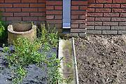 Nederland, Arnhem, 25-4-2017 Recent gebouwde koopwoningen, starterwoningen, in Malburgen Oost. Het hemelwater,regenwater, wordt niet in het riool, maar naar in grond afgevoerd.Foto: Flip Franssen