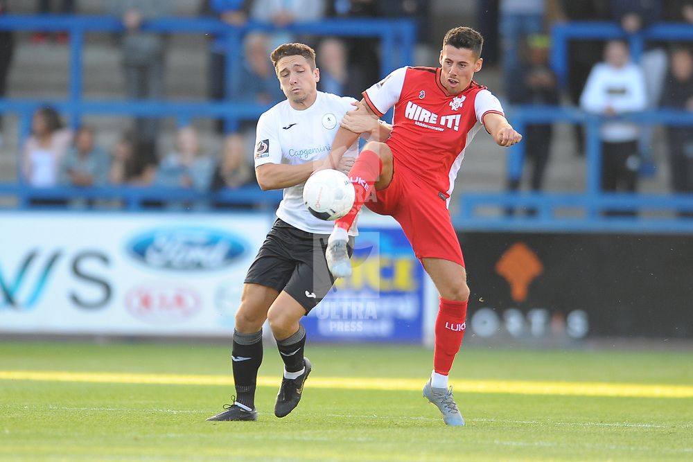 TELFORD COPYRIGHT MIKE SHERIDAN Adam Walker of Telford and Ashley Chambers of Kidderminster during the National League North fixture between AFC Telford United and Kidderminster Harriers on Tuesday, August 6, 2019.<br /> <br /> Picture credit: Mike Sheridan<br /> <br /> MS201920-006