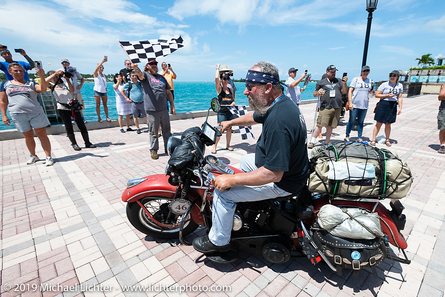 Matt Miller riding his 1947 Harley-Davidson Model U Flathead over the finish line of the Cross Country Chase motorcycle endurance run from Sault Sainte Marie, MI to Key West, FL. (for vintage bikes from 1930-1948). The Grand Finish in Key West's Mallory Square after the 110 mile Stage-10 ride from Miami to Key West, FL and after covering 2,368 miles of the Cross Country Chase. Sunday, September 15, 2019. Photography ©2019 Michael Lichter.