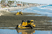 Catapillar Tractors Moving Sand On The Beach In Carlsbad