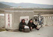 NORTH KOREA:<br /> The pictures Kim Jong Un doesn't want you to see<br /> <br /> Since 2008, Eric Lafforgue ventured to North Korea six times. Thanks to digital memory cards, I was able to save photos that I was forbidden to take or was told to delete by the minders.<br /> <br /> Photo Shows:   There are a lot of tired people since many have to ride their bikes for hours to go to work in the fields. Taking pictures of them is forbidden.<br /> ©Eric Lafforgue/Exclusivepix Media