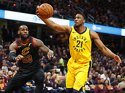 April 25, 2018 - Cleveland, OH, USA - The Indiana Pacers' Thaddeus Young, right, grabs a rebound against the Cleveland Cavaliers' LeBron James in the first quarter in Game 5 of a first-round playoff series on Wednesday, April 25, 2018, at Quicken Loans Arena in Cleveland. (Credit Image: © Leah Klafczynski/TNS via ZUMA Wire)