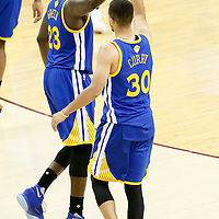 10 June 2016: Golden State Warriors forward Draymond Green (23) congratulates Golden State Warriors guard Stephen Curry (30) during the Golden State Warriors 108-97 victory over the Cleveland Cavaliers, during Game Four of the 2016 NBA Finals at the Quicken Loans Arena, Cleveland, Ohio, USA.