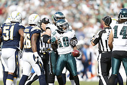 Philadelphia Eagles wide receiver DeSean Jackson #10 is held back by a teammate after a play during the NFL game between the San Diego Chargers and the Philadelphia Eagles in Philadelphia. The Chargers won 33-30. (Photo by Brian Garfinkel)