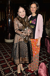 Left to right, the DOWAGER VISCOUNTESS ROTHERMERE and the MARCHIONESS OF WORCESTER at the Pig Pledge Evening at Club no41, 41 Conduit Street, London on 10th March 2014.