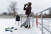 Out-of-work chef Phil, exercises alone in a snowy landscape at the empty open-air gym in Brockwell Park, south London during the third lockdown of the Coronavirus pandemic. Furloughed since last October and feeling the need to escape his nearby flat, he regularly visits this outdoor facility which is usually busy with south London fitness enthusiasts, on 8th February 2021, in London, England.