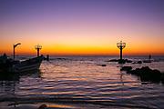 Israel, Northern Coastal Plains, Jisr Az Zarqa, the small natural protected fishing harbour at sunset