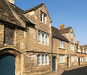 Row of historic homes in the village of Lacock, Wiltshire, England, UK