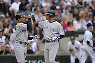 CHICAGO - AUGUST 1:  Derek Jeter #2 celebrates with Jerry Hairston Jr. #17 (L)  of the New York Yankees during the game against the Chicago White Sox on August 1, 2009 at U.S. Cellular Field in Chicago, Illinois.  The White Sox defeated the Yankees 14-4.  (Photo by Ron Vesely)
