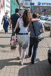 stock photo of a couple walking down the street in russia