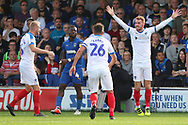 Portsmouth midfielder Tom Naylor (7) celebrating after scoring goal to make it 0-1 during the EFL Sky Bet League 1 match between AFC Wimbledon and Portsmouth at the Cherry Red Records Stadium, Kingston, England on 13 October 2018.