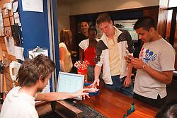 Teenagers in cinema buying tickets.
