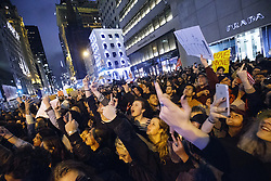 November 9, 2016 - New York, New York, U.S. - Anti-Trump demonstrators give the finger outside Trump Tower after marching from Union Square following the presidential election win by Donald Trump. (Credit Image: © Tolga Akmen/London News Pictures via ZUMA Wire)