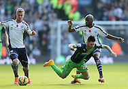 Remy Cabella of Newcastle United is disposed by Youssuf Mulumbu of West Bromwich Albion - Barclays Premier League - WBA vs Newcastle Utd - Hawthorns Stadium - West Bromwich - England - 9th November 2014  - Picture Simon Bellis/Sportimage