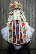 Lena, member of the Trachtengruppe Klein Meckelsen, is wearing a traditional costume in Klein Meckelsen, Lower Saxony, Germany on March 25, 2018.<br /> <br /> The traditional costume and the bridal crown are replicas of the original costumes.