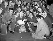 05/12/1961<br /> 12/05/1961<br /> 05 December 1961<br /> Gael Linn - children returning from the Gaeltacht at Westland Row (Pearse) Station. Girl shows her goose to the other children.