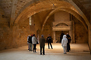 Lay Brothers Refectory at Fontfroide Abbey near Narbonne, France. Fontfroide Abbey is a former Cistercian monastery in France, situated 15 kilometers south-west of Narbonne. It was founded in 1093 by Aimery I, Viscount of Narbonne, but remained poor and obscure, and needed to be refounded by Ermengarde, Viscountess of Narbonne. The abbey fought together with Pope Innocent III against the heretical doctrine of the Cathars who lived in the region. It was dissolved in 1791 in the course of the French Revolution. The premises, which are of very great architectural interest, passed into private hands in 1908, when the artists Gustave and Madeleine Fayet dAndoque bought it to protect the fabric of the buildings from an American collector of sculpture. They restored it over a number of years and used it as a centre for artistic projects. It still remains in private hands. Today it is open to paying guests.
