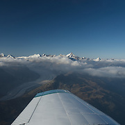 Aerial view from a plane over a beautiful glacier in the Swiss alps.
