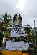Rear view of crossroad statue of elephant god Ganesh (Ganesha, Gannesha) with ancient Hindu symbol, the swastika. Sanur, Bali, Indonesia.