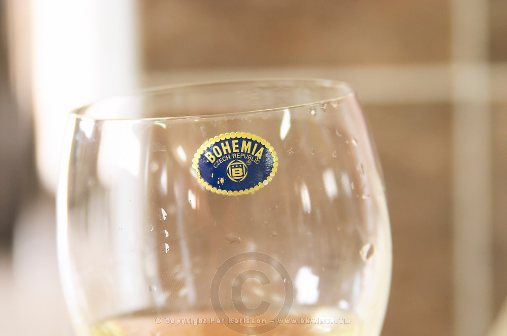 A wine glass with a sticker that indicates that the glass is made of Bohemian crystal Kantina Miqesia or Medaur winery, Koplik. Albania, Balkan, Europe.