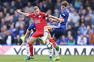 Marcos Alonso of Chelsea and Marc Albrighton of Leicester City in action. Premier league match, Chelsea v Leicester city at Stamford Bridge in London on Saturday 15th October 2016.<br /> pic by John Patrick Fletcher, Andrew Orchard sports photography.