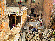 01 MARCH 2017 - BUNGAMATI, NEPAL: Workers start to rebuild a home in Bungamati destroyed in the 2015 earthquake. Recovery seems to have barely begun nearly two years after the earthquake of 25 April 2015 that devastated Nepal. In some villages in the Kathmandu valley workers are working by hand to remove ruble and dig out destroyed buildings. About 9,000 people were killed and another 22,000 injured by the earthquake. The epicenter of the earthquake was east of the Gorka district.     PHOTO BY JACK KURTZ