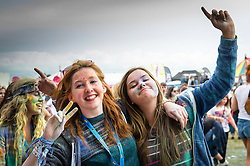 Festivalgoers covered in paint at the Brownstock Festival in Essex.