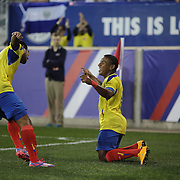 Joao Plata, Ecuador, is congratulated by team mate Junior Sornoza, after scoring during the Ecuador Vs El Salvador friendly international football match at Red Bull Arena, Harrison, New Jersey. USA. 14th October 2014. Photo Tim Clayton