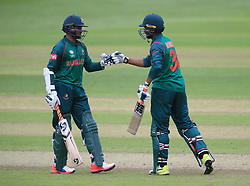 Bangladesh's Shakib Al Hasan (left) and Mahmudullah touch gloves during the ICC Champions Trophy, Group A match at Sophia Gardens, Cardiff.