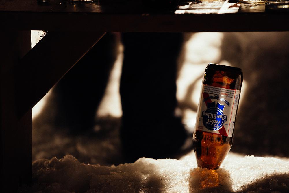 Empty PBR bottle in the snow.