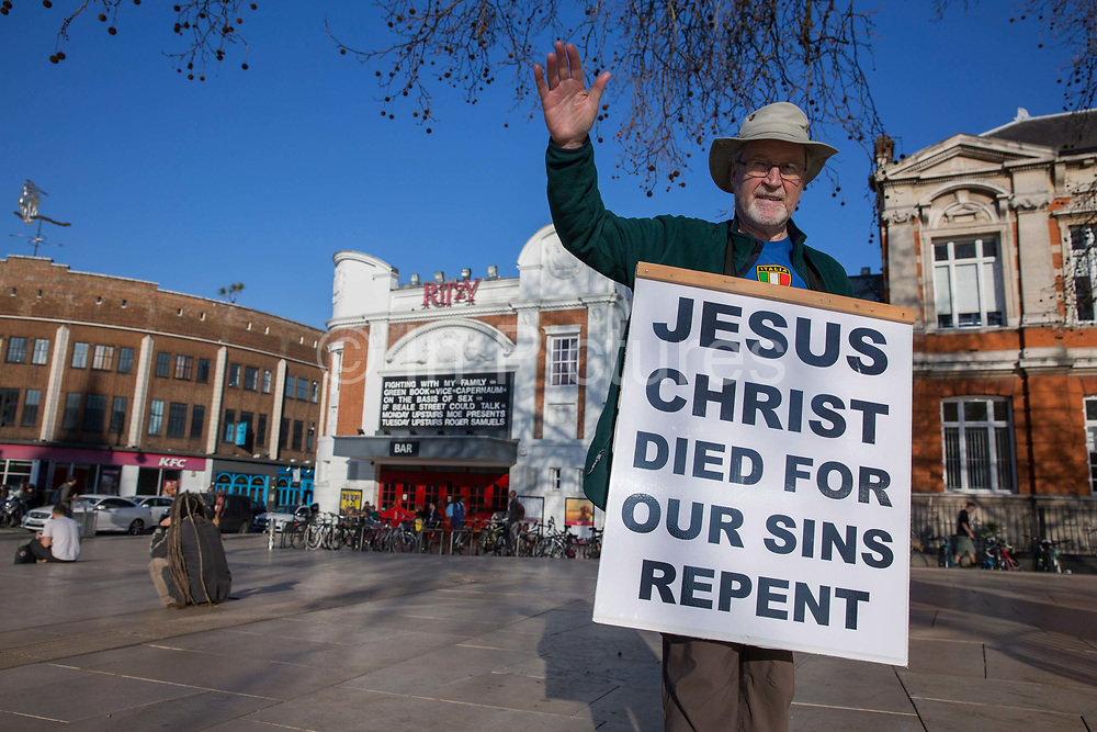 Kenneth the Christian preaching at Windrush Square on the 25th February 2019 in Brixton in the United Kingdom. A new English record was set on this day with temperatures rising to 20.1C in south-west London. It is the first time a temperature of over 20C has been recorded in England during winter.