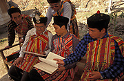 """Elders from the Lepcha community look at written documents during a gathering during which they celebrate their culture and language while discusing their loss of identity, on 18th June 1995, in Kalimpong, West Bengal, India. The Lepcha are also called the Rongkup meaning the children of God and the Rong, Mutunci Rongkup Rumkup """"beloved children of the Rong and of God""""), and Rongpa are among the indigenous peoples of Sikkim, India and number between 30,000 and 50,000. Many Lepcha are also found in western and southwestern Bhutan, Tibet, Darjeeling, the Mechi Zone of eastern Nepal, and in the hills of West Bengal."""