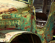 An old Dodge pickup truck near Elizabeth, New Mexico shows it's colorful past as rust and years of paint are displayed.