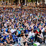 Vancouver, British Columbia, Canada - June 6, 2011 - A crowd gathered along Georgia Street near the CBC studio to enjoy a hockey playoff game (Vancouver 1-8 Boston).<br /> <br /> Photo: © Rod Mountain<br /> <br /> http://www.rodmountain.com<br /> <br /> Nikon / Nikkor Lens<br /> @nikoncanada #NikonCA<br /> @NikonUSA #NikonNoFilter<br /> @nikoneurope #NikonEurope<br /> <br /> https://en.m.wikipedia.org/wiki/Vancouver_Canucks<br /> <br /> #sport #fans #hockeylife #hockeyfan #2011 #vancouver #vancity #VancouverCanada #cbc #crowd #latergram #hockey #vancouvercanucks #playoffs #Canada #BritishColumbia