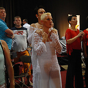 "Sonja Godee, center front, (accent on the first ""e"" in Godee) and Monique Stroes, both of Holland, watch the competition between dances in the adult women's standard division of the same-sex ballroom dancing competition during the 2007 Eurogames at the Waagnatie hangar in Antwerp, Belgium on July 14, 2007. ..Over 3,000 LGBT athletes competed in 11 sports, including same-sex dance, during the 11th annual European gay sporting event. Same-sex ballroom is a growing sports that has been happening in Europe for over two decades."
