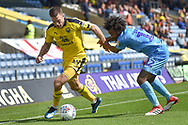 Oxford United striker Jamie Mackie (19) battles for the ball with Coventry City defender Junior Brown (12) during the EFL Sky Bet League 1 match between Oxford United and Coventry City at the Kassam Stadium, Oxford, England on 9 September 2018.
