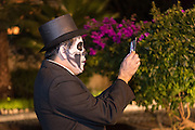 A man dressed as the dapper skeleton takes a camera phone photo during the Day of the Dead festival November 1, 2016 in San Miguel de Allende, Guanajuato, Mexico. The week-long celebration is a time when Mexicans welcome the dead back to earth for a visit and celebrate life.