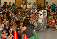 Whiskers the mascot sits with Woodland Height Elementary School students during their assembly on PBIS (Positive Behavioral Intervention Supports) Thursday afternoon. (Karen Bobotas/for the Laconia Daily Sun)
