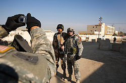 Lt. Col. Alan Kelly, commander of the 1st Infantry, 17th Regiment, has his picture taken with a soldier with the Iraqi Army, Mosul, Iraq, Dec. 14, 2005. They are patrolling western Mosul as part of an effort to provide security in preparation for Iraq's first  post-Saddam parliamentary elections. The western sector is home to Mosul's primarily Sunni population, which has been resistant to the American presence in Iraq.