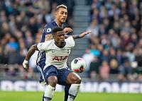 Football - 2019 / 2020 Premier League - Tottenham Hotspur vs. Watford<br /> <br /> Serge Aurier (Tottenham FC) defends the ball from Roberto Pereyra (Watford FC) at The Tottenham Hotspur Stadium.<br /> <br /> COLORSPORT/DANIEL BEARHAM