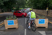 a motorist turns round at the pedestrianised road junction at Carlton Avenue, Court Lane and Dulwich Village which has been blocked off to passing traffic with plant boxes at the corner as part of emergency Coronavirus pandemic policy to keep pedestrians safe at the expense of traffic, the first phase in an experimental road layout, on 30th June 2020, in London, England. Southwark was awarded £1.3 million by TfL from its Streetspace funding pot, which aims to rapidly transform London's streets to help facilitate social distancing, cycling, and walking as lockdown eases. Dulwich Village low traffic neighbourhood was granted £23,000 for the first phase and £110,000 for the second. As part of its 'our healthy streets' initiative, the council had already earmarked the Village as an LTN.