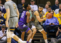 Jan 14, 2020; Morgantown, West Virginia, USA; West Virginia Mountaineers guard Jermaine Haley (10) is guarded by TCU Horned Frogs guard RJ Nembhard (22) along the baseline during the first half at WVU Coliseum. Mandatory Credit: Ben Queen-USA TODAY Sports