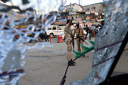 September 7, 2017 - India - Indian policemen stand vigilant at the site of grenade explosion. One civilian was killed and 13 others including a traffic policeman were injured when suspected militants lobbed a grenade towards paramilitary CRPF vehicle at Jehangir Chowk in Srinagar. (Credit Image: © Umer Asif/Pacific Press via ZUMA Wire)