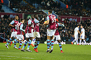 Rudy Gestede of Aston Villa (39) celebrates with his teammates after he scores his teams 1st goal to make it 1-1. Barclays Premier league match, Aston Villa v Leicester city at Villa Park in Birmingham, The Midlands on Saturday 16th January 2016.<br /> pic by Andrew Orchard, Andrew Orchard sports photography.
