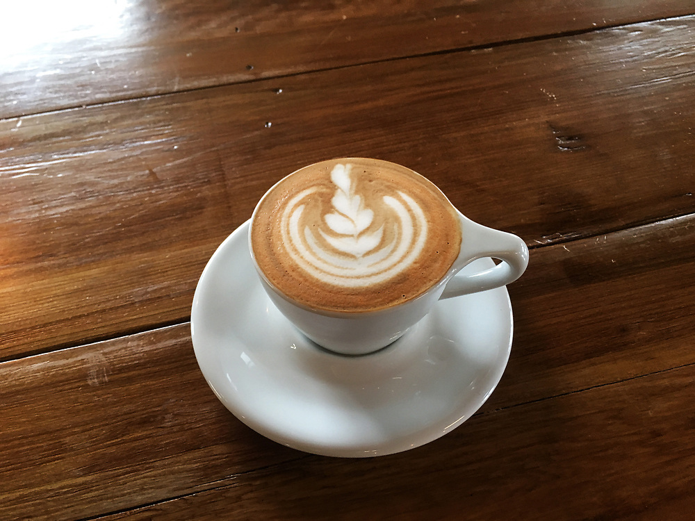 An overhead view of a cup of cappuccino