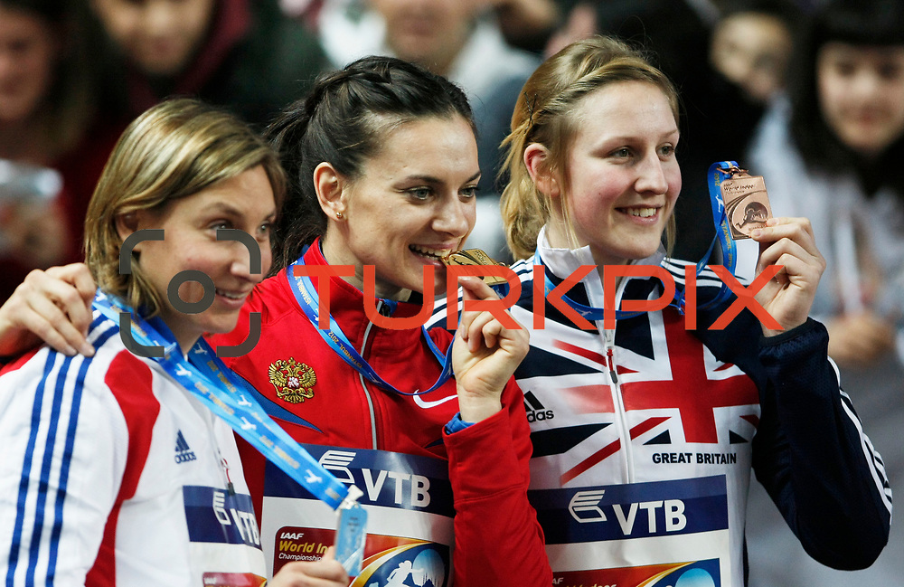 Gold medallist Yelena Isinbayeva (C) of Russia poses on the podium with France's silver winner Vanessa Boslak (L) and Great Britain's bronze medallist Holly Bleasdale during the medal ceremony for the women's pole vault at during the IAAF World Indoor Championships at the Atakoy Athletics Arena, Istanbul, Turkey. Photo by TURKPIX