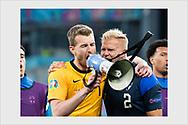 Lukas Hradecky and Paulus Arajuuri after Finland wins a historical first ever final tournament match. Denmark - Finland. Copenhagen, June 12, 2021.